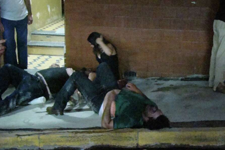 Injured people lies on the ground outside the Kiss nightclub in Santa Maria city,  Rio Grande do Sul