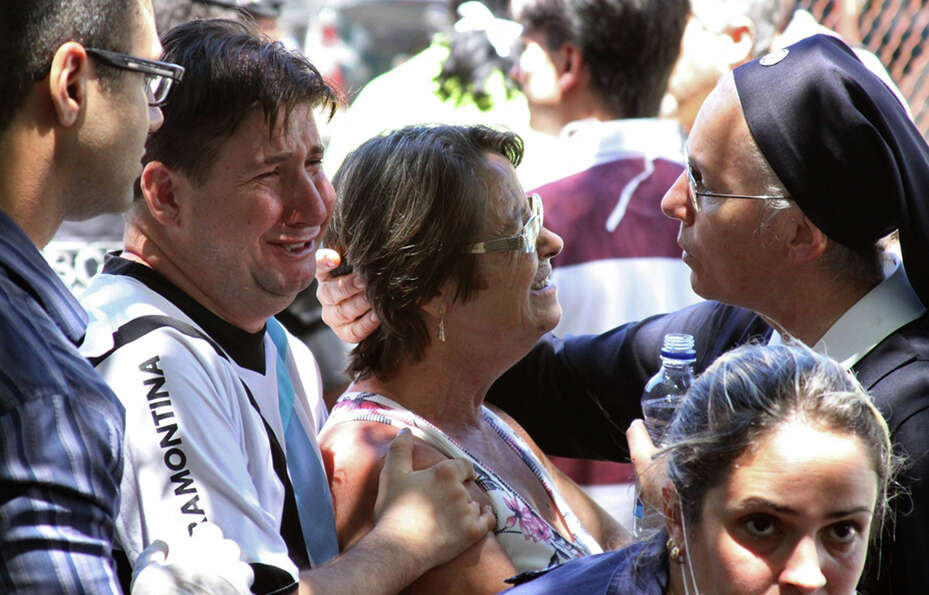 Relatives of victims react in Santa Maria city, Rio Grande do Sul state, Brazil, Sunday, Jan. 27, 20