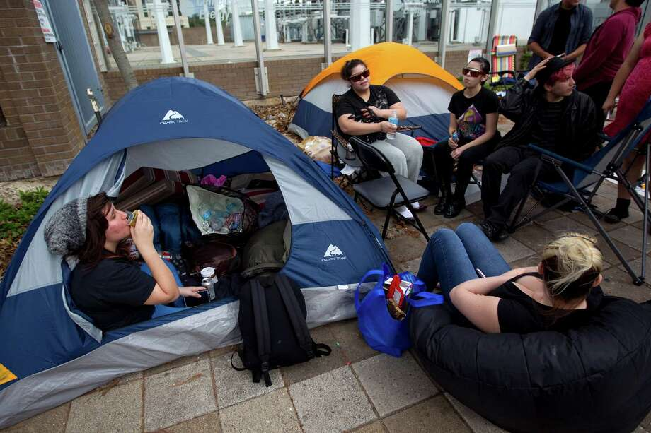 "Ryan Wiseman, 14, left, of Copperas Cove sits in her tent as a group of people wait in line across the street from Toyota Center for this week's Lady Gaga concert Sunday, Jan. 27, 2013, in Houston.  ""I just got here today but some of the others have been here since Thursday,"" Wiseman said as they wait for the Thursday, January 31 concert. Photo: Johnny Hanson, Houston Chronicle / © 2013  Houston Chronicle"