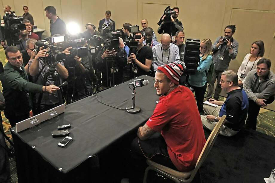 Quarterback Colin Kaepernick is surrounded by news media while he answers questions as the San Francisco 49ers hold their first press conference after arriving in New Orleans Louisiana  on Sunday Jan. 27,  2013. Photo: Michael Macor, The Chronicle