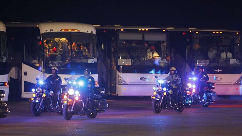The player's buses are given a police escort as the San Francisco 49ers' football team arrives at the Louis Armstrong New Orleans International Airport in New Orleans Louisiana  on Sunday Jan. 27,  2013. Photo: Michael Macor, The Chronicle