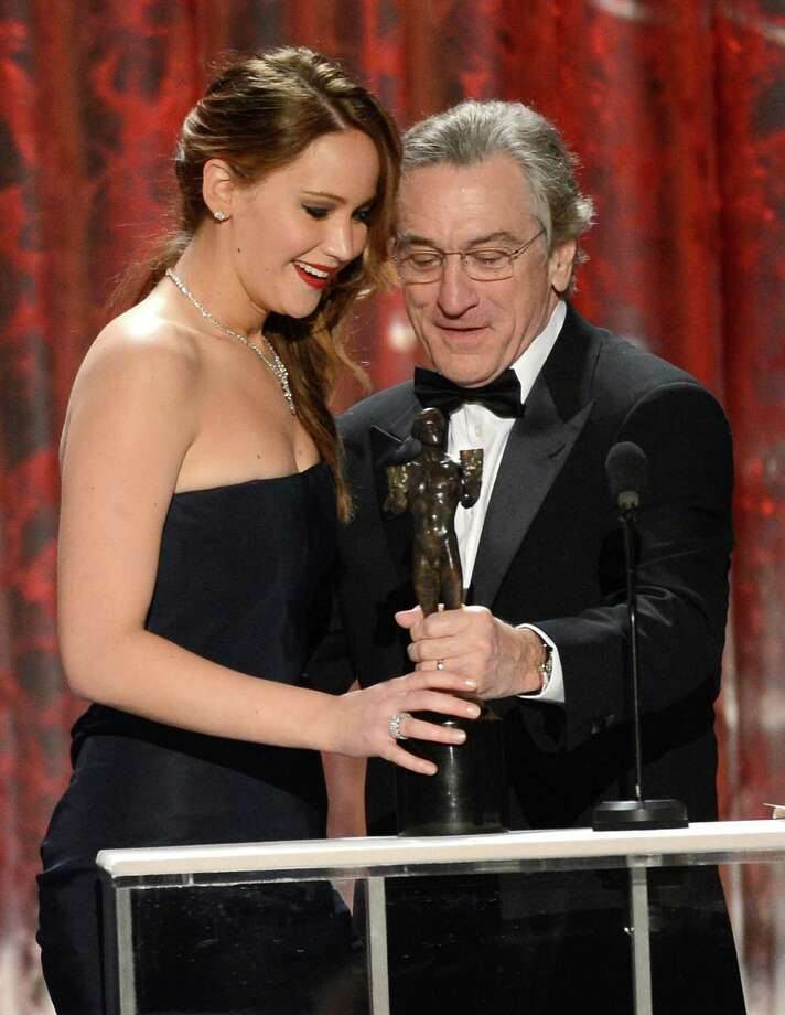 "Actor Robert De Niro, at left, presents Jennifer Lawrence with the best actress in a leading role for the ""Silver Linings Playbook."" Daniel Day-Lewis, above, took the best actor award for his role in ""Lincoln."" Photo: Mark Davis, Staff / 2013 Getty Images"