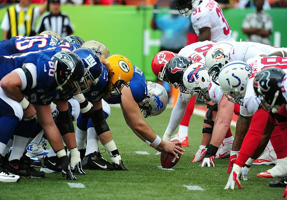 Mad Hatter? No, just the Pro Bowl: NFC (left) and AFC players, each in his own helmet, ready for a snap. Photo: Scott Cunningham, Getty Images