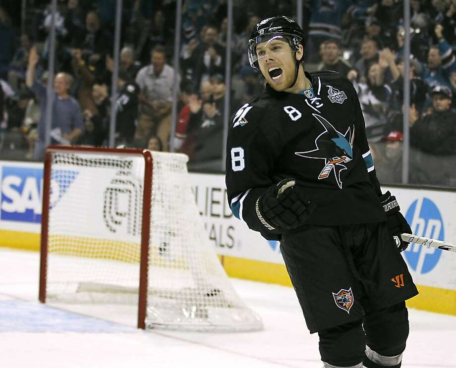 San Jose Sharks center Joe Pavelski celebrates after scoring a goal against Vancouver Canucks during the first period of an NHL hockey game in San Jose, Calif., Sunday, Jan. 27, 2013. (AP Photo/Tony Avelar) Photo: Tony Avelar, Associated Press