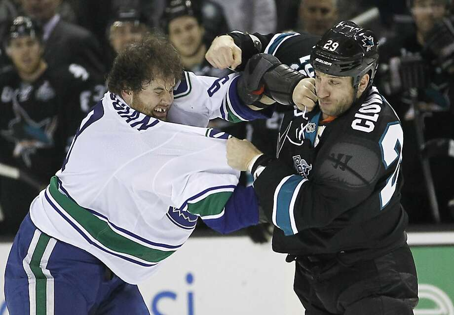San Jose Sharks right wing Ryane Clowe (29) fights with Vancouver Canucks right wing Zack Kassian (9) during the first period of an NHL hockey game in San Jose, Calif., Sunday, Jan. 27, 2013. (AP Photo/Tony Avelar) Photo: Tony Avelar, Associated Press