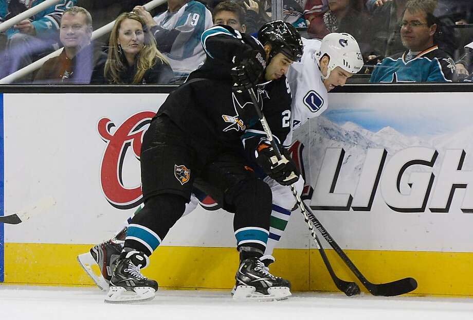 SAN JOSE, CA - JANUARY 27:  Scott Gomez #23 of the San Jose Sharks battles for control of the puck with Dale Weise #32 of the Vancouver Canucks in the third period of their game at HP Pavilion on January 27, 2013 in San Jose, California. The Sharks won the game 4-1. (Photo by Thearon W. Henderson/Getty Images) Photo: Thearon W. Henderson, Getty Images