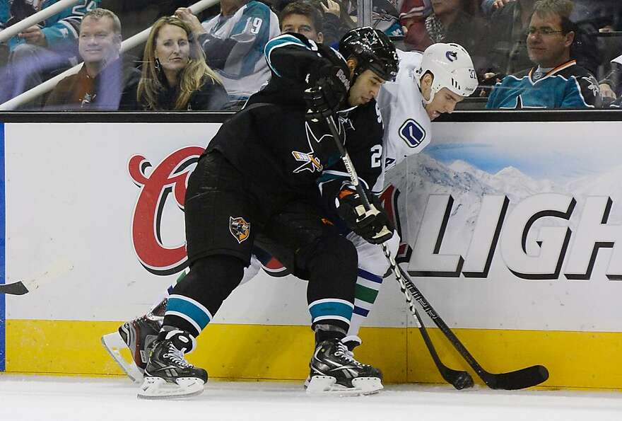 SAN JOSE, CA - JANUARY 27:  Scott Gomez #23 of the San Jose Sharks battles for control of the puck w