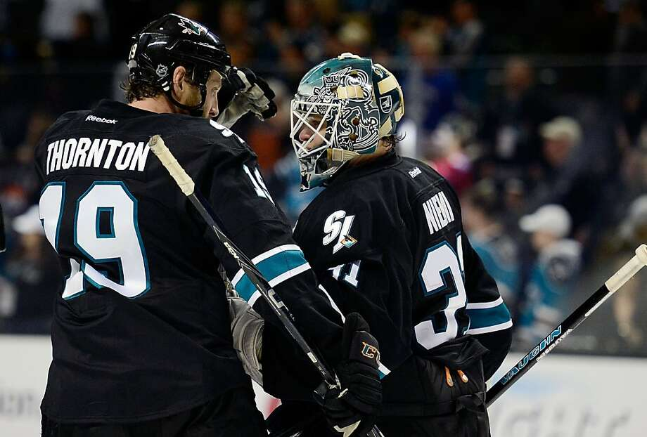 SAN JOSE, CA - JANUARY 27:  Joe Thornton #19 and Antti Niemi #31 of the San Jose Sharks celebrate defeating the Vancouver Canucks 4-1 at HP Pavilion on January 27, 2013 in San Jose, California.  (Photo by Thearon W. Henderson/Getty Images) Photo: Thearon W. Henderson, Getty Images