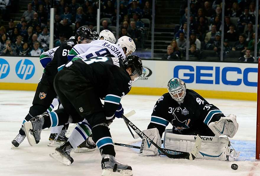 SAN JOSE, CA - JANUARY 27:  Antti Niemi #31 of the San Jose Sharks blocks the shot of  Zack Kassian