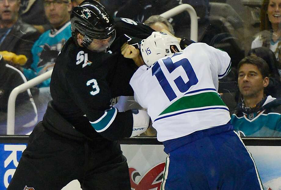 SAN JOSE, CA - JANUARY 27:  Douglas Murray #3 of the San Jose Sharks fights with Aaron Volpatti #15 of the Vancouver Canucks in the third period of their game at HP Pavilion on January 27, 2013 in San Jose, California. The Sharks won the game 4-1.  (Photo by Thearon W. Henderson/Getty Images) Photo: Thearon W. Henderson, Getty Images