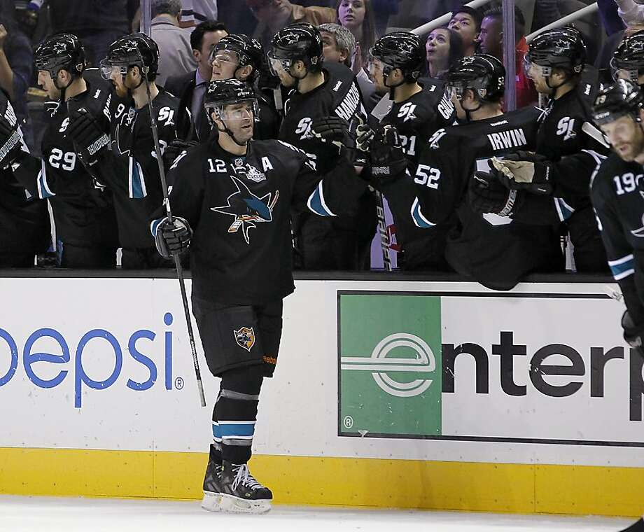 San Jose Sharks center Patrick Marleau (12) high-fives teammates after scoring against the Vancouver Canucks during the second period of an NHL hockey game in San Jose, Calif., Sunday, Jan. 27, 2013. (AP Photo/Tony Avelar) Photo: Tony Avelar, Associated Press