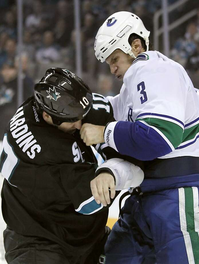Vancouver Canucks defenseman Kevin Bieksa (3) fights with San Jose Sharks center Andrew Desjardins (10) during the third period of an NHL hockey game in San Jose, Calif., Sunday, Jan. 27, 2013. San Jose won 4-1. (AP Photo/Tony Avelar) Photo: Tony Avelar, Associated Press