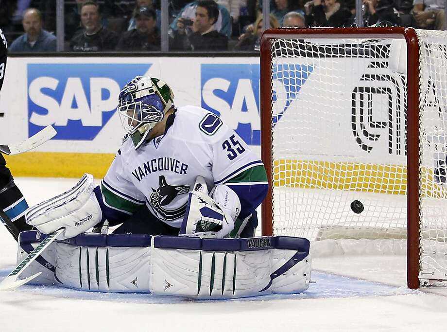 Vancouver Canucks goalie Cory Schneider looks back as San Jose Sharks center Joe Pavelski scored a goal during the third period of an NHL hockey game in San Jose, Calif., Sunday, Jan. 27, 2013. San Jose won 4-1. (AP Photo/Tony Avelar) Photo: Tony Avelar, Associated Press
