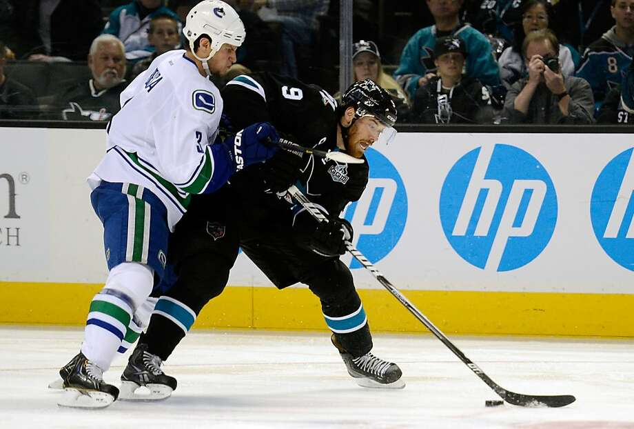 SAN JOSE, CA - JANUARY 27:  Martin Havlat #9 of the San Jose Shark controls the puck keeping it away from Kevin Bieksa #3 of the Vancouver Canucks in the second period of their game at HP Pavilion on January 27, 2013 in San Jose, California.  (Photo by Thearon W. Henderson/Getty Images) Photo: Thearon W. Henderson, Getty Images