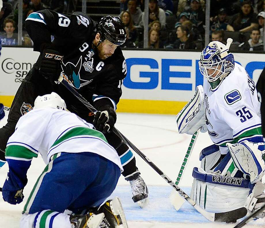 SAN JOSE, CA - JANUARY 27:  Cory Schneider #35 of the Vancouver Canucks blocks the shot of Joe Thornton #19 of the San Jose Sharks in the second period of their game at HP Pavilion on January 27, 2013 in San Jose, California.  (Photo by Thearon W. Henderson/Getty Images) Photo: Thearon W. Henderson, Getty Images