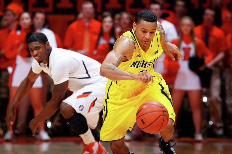 Michigan's Trey Burke is off and running after a steal from Illinois' Brandon Paul. Photo: Joe Robbins, Stringer / 2013 Getty Images