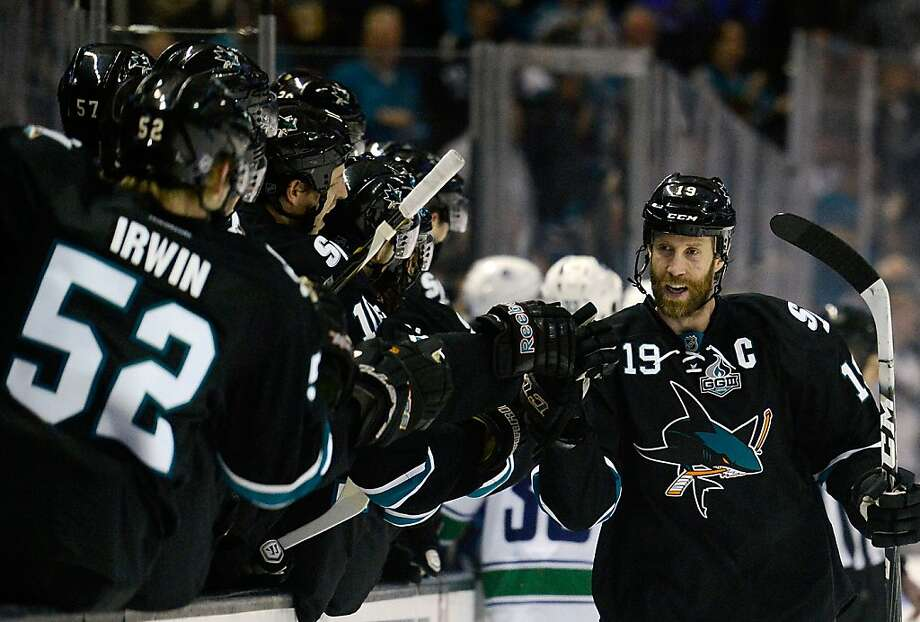 SAN JOSE, CA - JANUARY 27:  Joe Thornton #19 of the San Jose Sharks is congratulated by teammates after he scored a goal against the Vancouver Canucks in the first period of their game at HP Pavilion on January 27, 2013 in San Jose, California.  (Photo by Thearon W. Henderson/Getty Images) Photo: Thearon W. Henderson, Getty Images