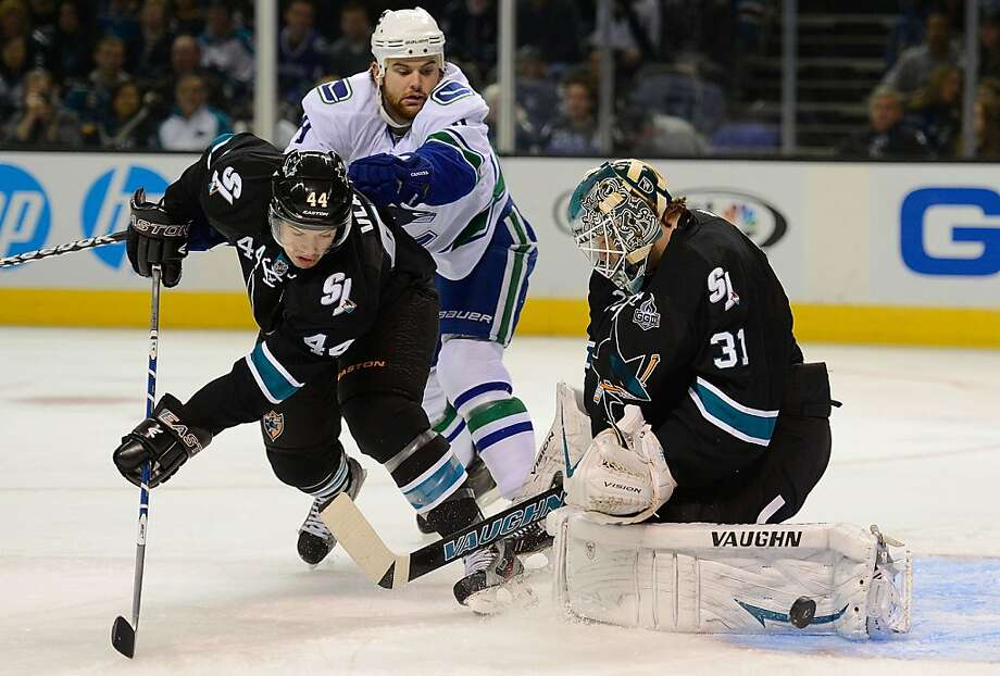 SAN JOSE, CA - JANUARY 27:  Antti Niemi #31 and Marc-Edouard Vlasic stops the rebound shot of Zack Kassian #9 of the Vancouver Canucks in the first period of their game at HP Pavilion on January 27, 2013 in San Jose, California.  (Photo by Thearon W. Henderson/Getty Images) Photo: Thearon W. Henderson, Getty Images