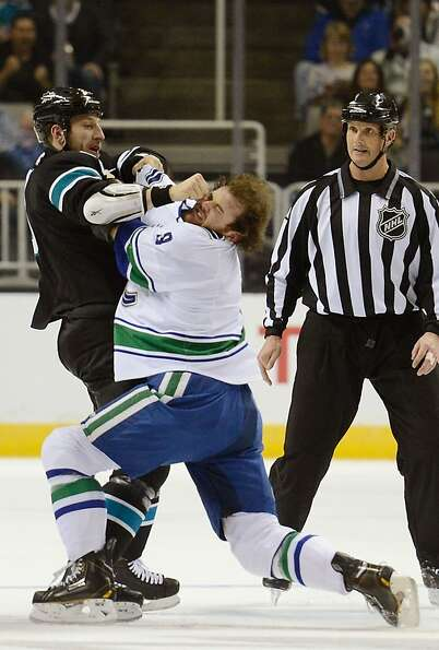 SAN JOSE, CA - JANUARY 27:  Ryane Clowe #29 of the San Jose Sharks fights with Zack Kassian #9 of th