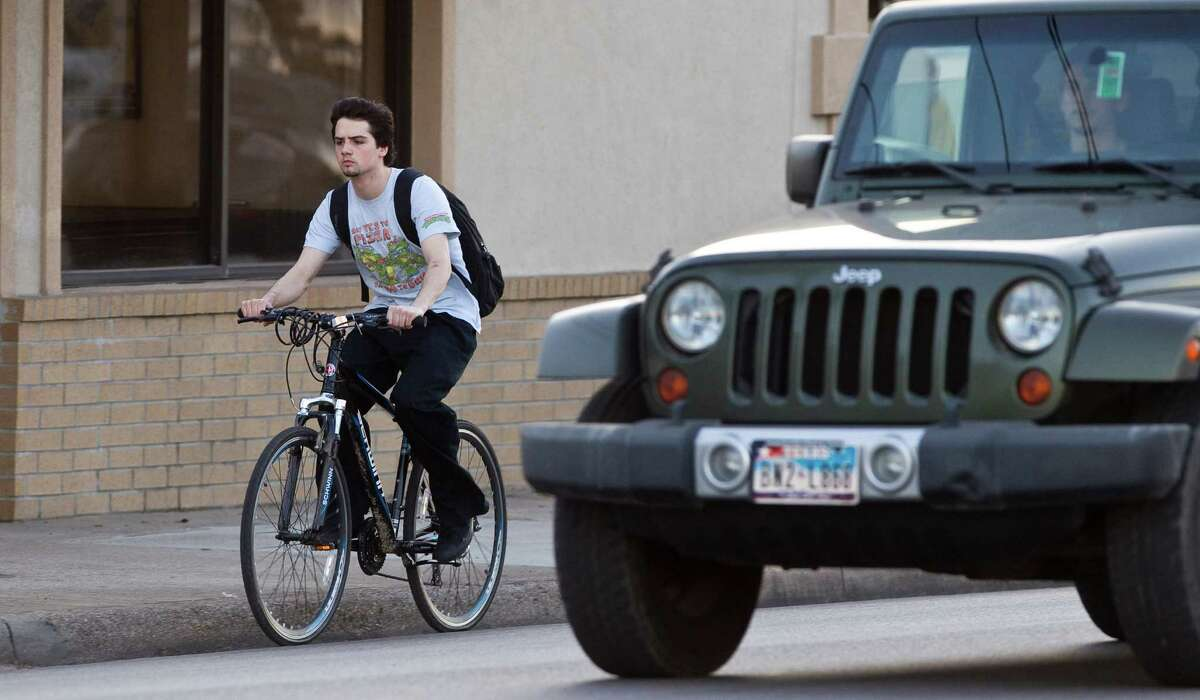 Bicyclists, like this one on Washington Avenue recently, say they're regularly passed within inches by motor vehicles. Lobbyists are pushing for new laws.