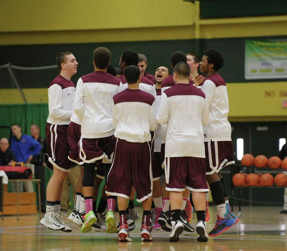 The Watervliet High School boy's basketball team gets fired up before their game against Voorheesville High School at the Siena College ARC on Sunday, Jan. 27, 2013 in Loudonville, NY.  (Paul Buckowski / Times Union) Photo: Paul Buckowski  / 10020888A