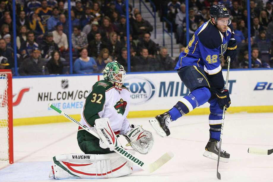 The Blues' David Backes does his best to annoy Wild goalie Niklas Backstrom, who made 32 saves. Photo: Dilip Vishwanat, Stringer / 2013 Getty Images