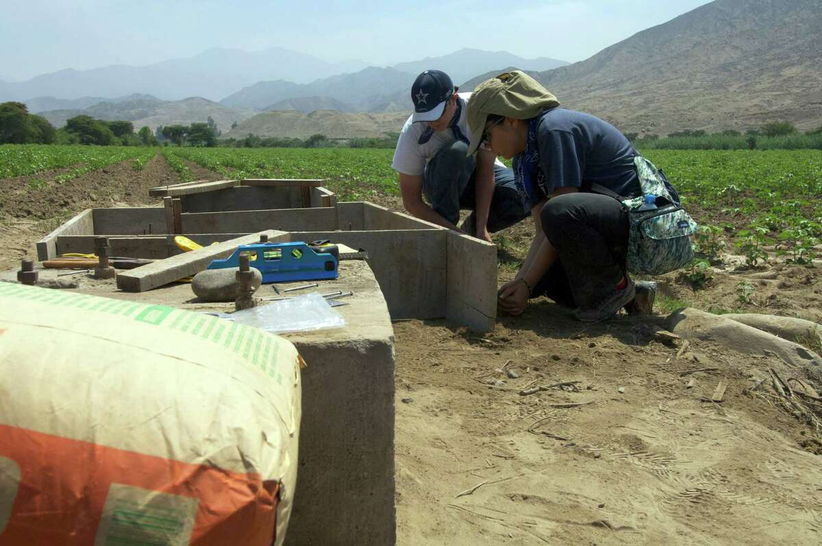 Adam Bazar (left) and Jessica George (right) are among the four students from the UTSA chapter of Engineers Without Borders who traveled to central Peru for 12 days in January to build a comprehensive water delivery system to bring water to town residents as part of a multi-year community development project.