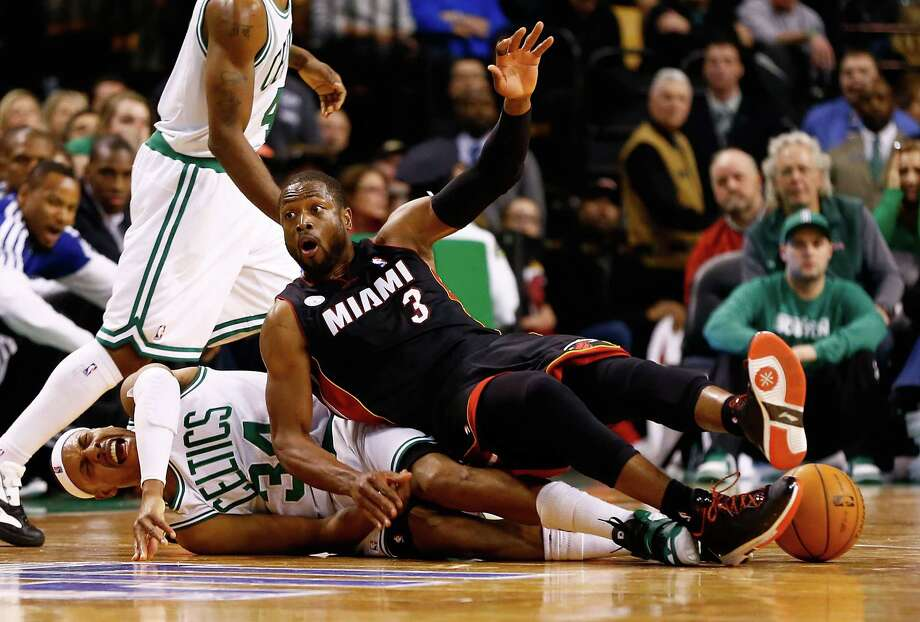 The Heat's Dwyane Wade (3) leaves the Celtics' Paul Pierce in pain. Photo: Jared Wickerham, Staff / 2013 Getty Images