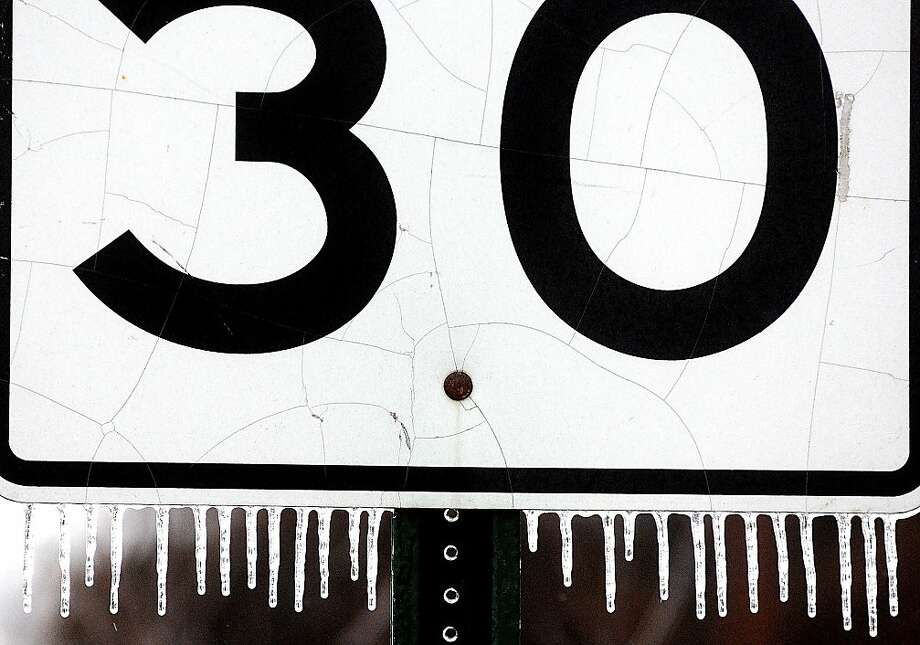 Ice accumulates on a speed limit sign on Second Street in Winona, Minn., on Sunday, Jan. 27, 2013, A wintry mix of freezing rain, sleet and snow made for dangerous road conditions on Sunday. Photo: Joe Ahlquist, Associated Press