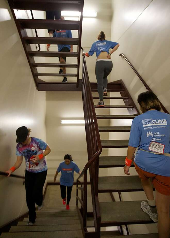 Participants climb the stairwells of the U.S. Bancorp Tower, Sunday,, Jann. 27, 2013, competing in the inaugural Kaiser Permanente Fight for Air Climb in Portland, Ore. The event was open to anyone, offering them the chance to climb 20, 40, 80 or even 160 flights of stairs in a fundraiser for the American Lung Association. Photo: Randy L. Rasmussen, Associated Press