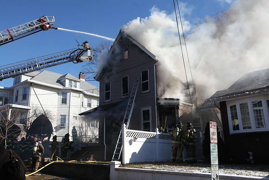 Firefighters battle a house fire at 88 High Street in East Rutherford, N.J., Sunday, Jan. 27, 2013. Photo: Chris Pedota, Associated Press