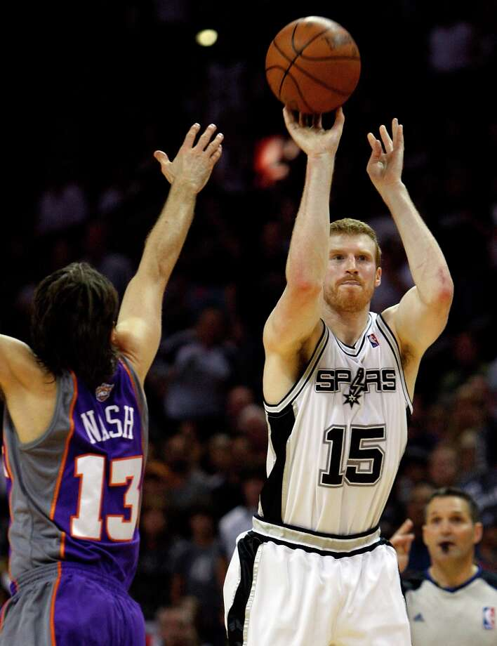The Spurs' Matt Bonner hoists up a shot against the Phoenix Suns' Steve Nash in the second half in Game 4 of the Western Conference semifinals at the AT&T Center on Sunday, May 9, 2010. Photo: KIN MAN HUI, SAN ANTONIO EXPRESS-NEWS / San Antonio Express-News