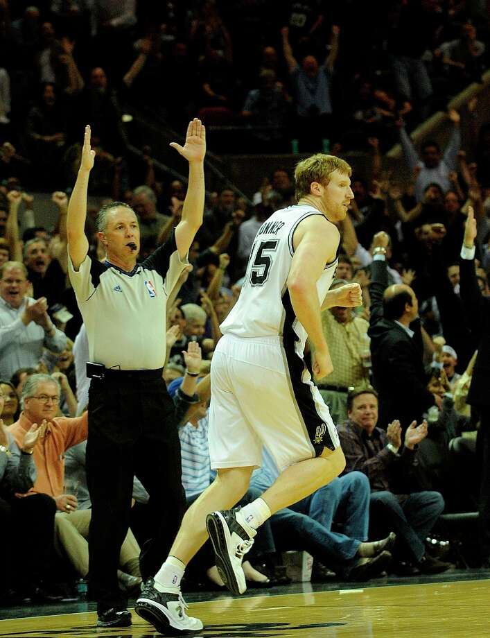 Matt Bonner runs after hitting a 3-point shot late against Oklahoma City in NBA action at the AT&T Center on  Feb. 23, 2011. Photo: BILLY CALZADA, SAN ANTONIO EXPRESS-NEWS / gcalzada@express-news.net