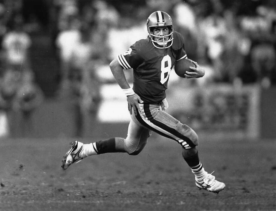 Steve Young, who beat Minnesota on this run, was a dynamic passer and runner, somewhat like present-day quarterback Colin Kaepernick. Photo: Tom Levy, SFC