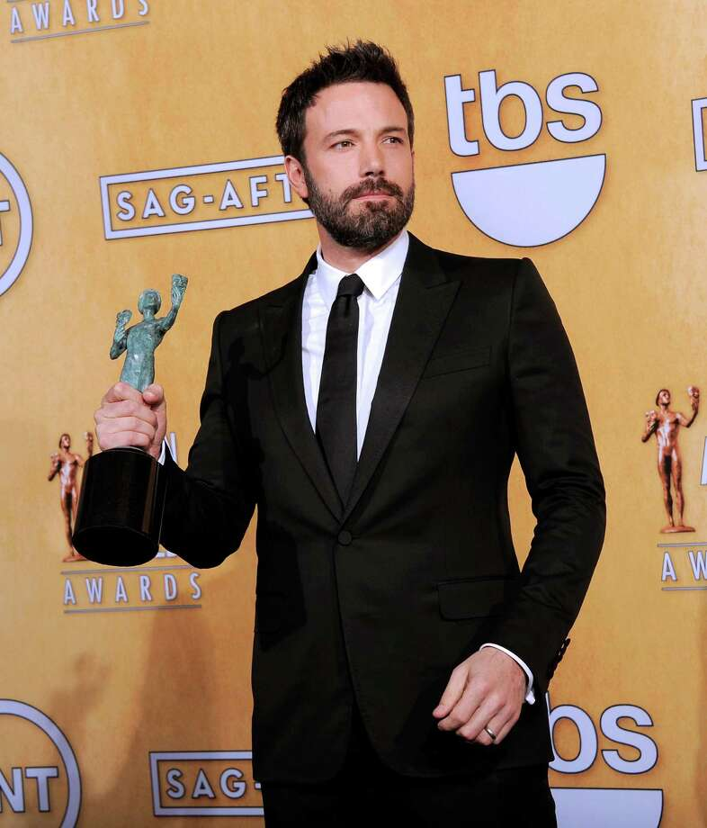 "Actor Ben Affleck poses backstage with the award for best cast in a motion picture for ""Argo"" at the 19th Annual Screen Actors Guild Awards at the Shrine Auditorium in Los Angeles on Sunday Jan. 27, 2013. (Photo by Chris Pizzello/Invision/AP) Photo: Chris Pizzello"