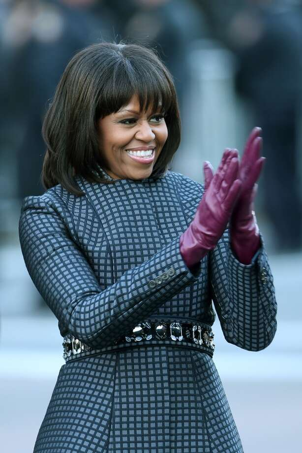 First lady Michelle Obama debuts a revamped short cut with bangs at the presidential inauguration in Washington, DC.