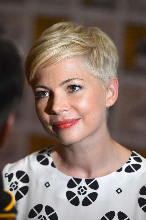 Actress Michelle Williams shows off her pixie cut during Comic-Con International 2012 in San Diego, California.