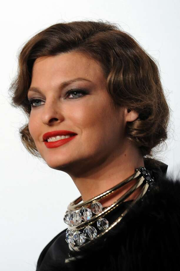 Former Canadian top model Linda Evangelista looks glamorous in her iconic cut at the American Foundation for AIDS research gala in Milan.