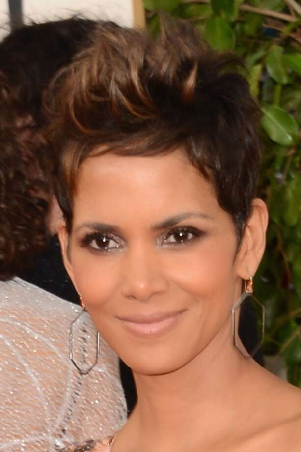 Actress Halle Berry with her signature edgy cut strolls the red carpet at the 70th Annual Golden Globe Awards in Beverly Hills, California.