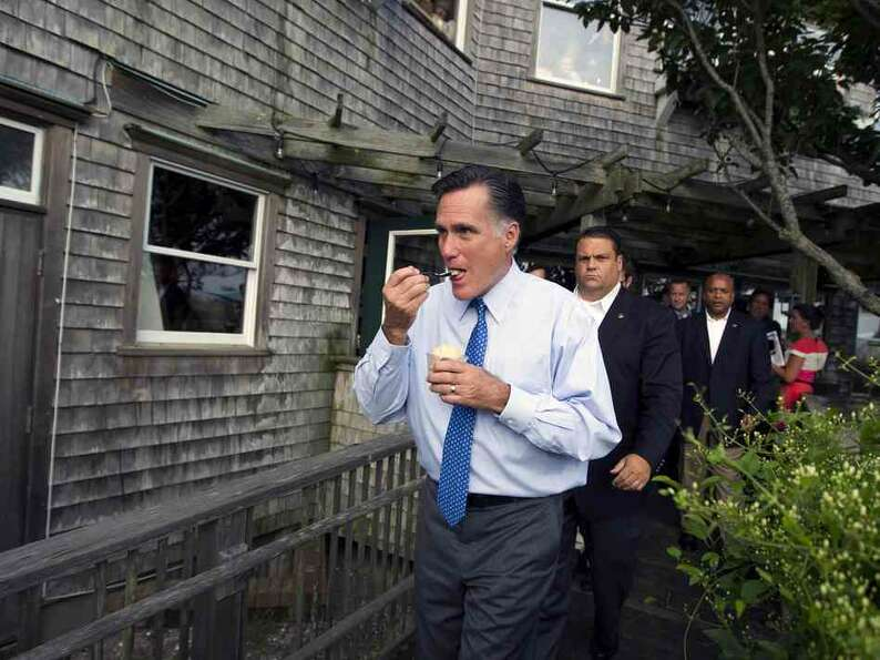 Republican presidential candidate Mitt Romney eats ice cream from Millie's on the run before a fundr