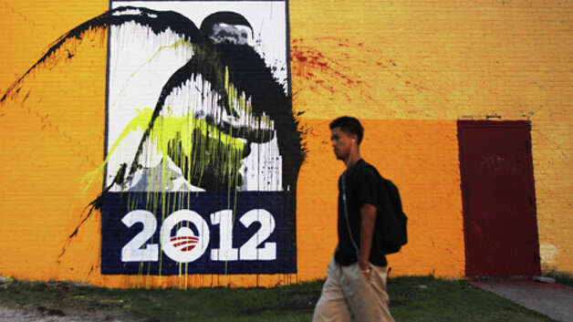 Vandals struck the Obama mural at Alabama and Travis. | Cody Duty / Houston Chronicle Photo: .