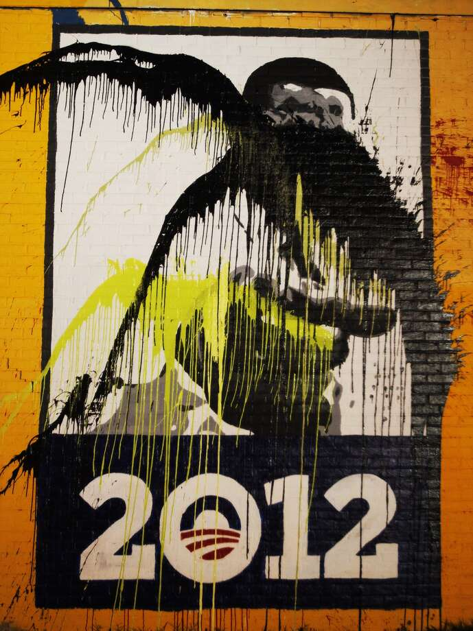 Vandals hit the Obama mural at Travis and Alabama overnight. | Cody Duty / Houston Chronicle Photo: .