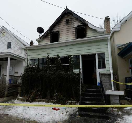 12 Arcadia Avenue Jan. 28, 2013 after a fire struck the home the previous morning in Albany, N.Y.  A body was found in the building after the fire was put out prompting the police presence.  (Skip Dickstein/Times Union) Photo: SKIP DICKSTEIN / 00020930A