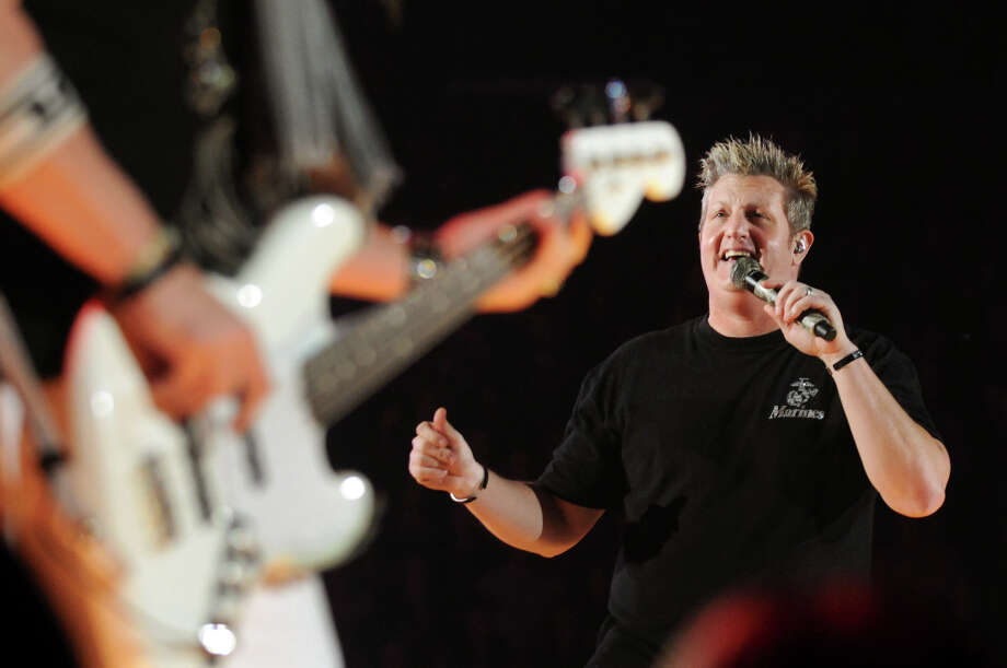 Jay DeMarcus, left, and Gary LeVox of Rascal Flatts perform Thursday, Jan. 26, 2012, at Times Union Center in Albany, N.Y. (Cindy Schultz / Times Union) Photo: Cindy Schultz, Albany Times Union / 00016197A