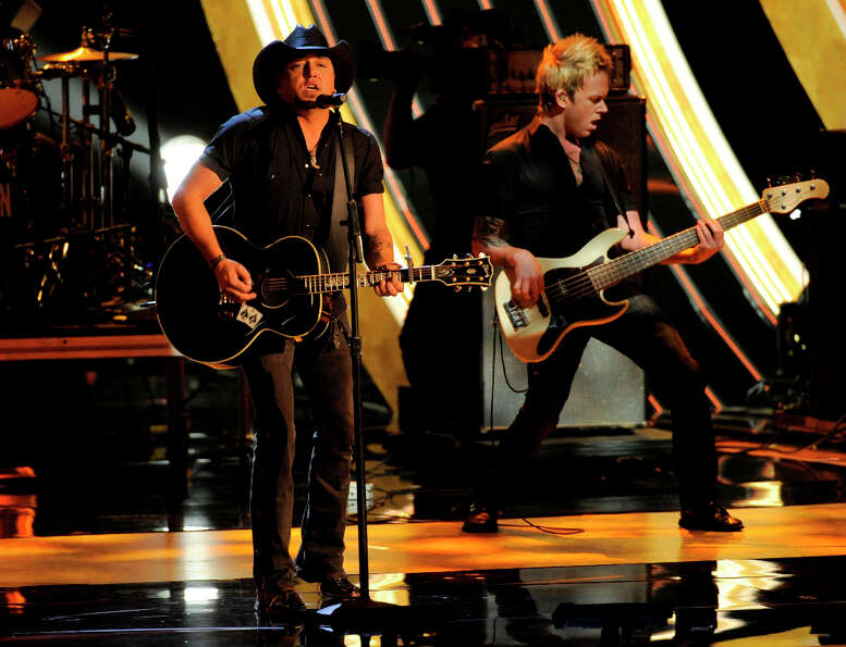 Jason Aldean, left, performs at the People's Choice Awards at the Nokia Theatre on Wednesday