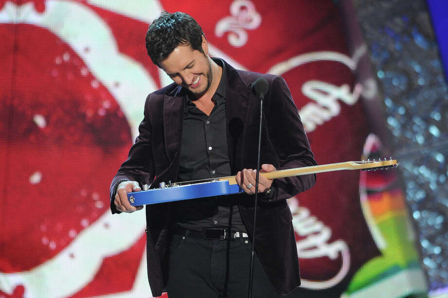 Luke Bryan accepts the award for 'Artist of the Year' during the American Country Awards on Monday, Dec. 10, 2012, in Las Vegas. (Photo by Al Powers/Powers Imagery/Invision/AP) Photo: Al Powers, Al Powers/Invision/AP / Invision