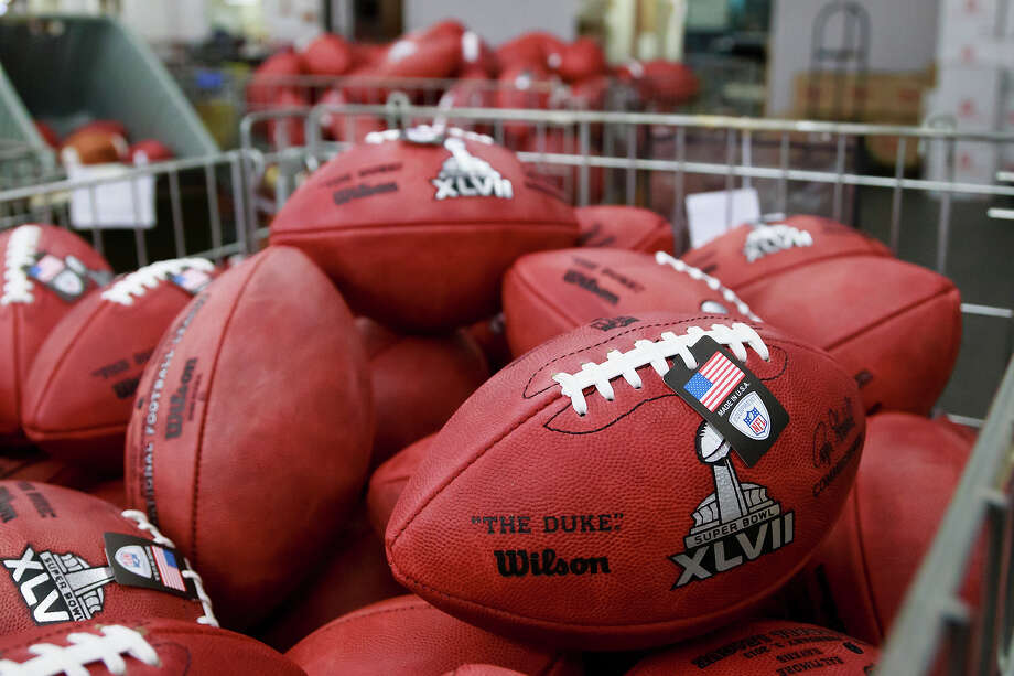 Footballs selected as actual official game balls for the NFL football Super Bowl XLVII await to be shipped to New Orleans at Wilson Sporting Goods Co. in Ada, Ohio, Monday, Jan. 21, 2013. The San Francisco Forty Niners will play the Baltimore Ravens in the Super Bowl on Feb. 3 in New Orleans. (AP Photo/Rick Osentoski) Photo: Rick Osentoski, ASSOCIATED PRESS / AP2013