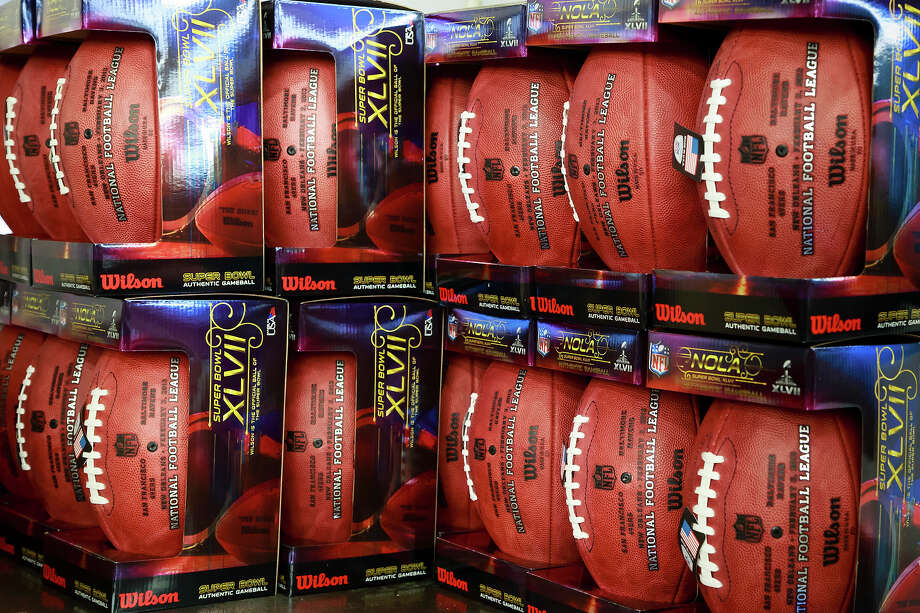 Footballs for the NFL football Super Bowl XLVII await to be shipped at Wilson Sporting Goods Co. in Ada, Ohio, Monday, Jan. 21, 2013. The San Francisco Forty Niners will play the Baltimore Ravens in the Super Bowl on Feb. 3 in New Orleans. (AP Photo/Rick Osentoski) Photo: Rick Osentoski, ASSOCIATED PRESS / AP2013