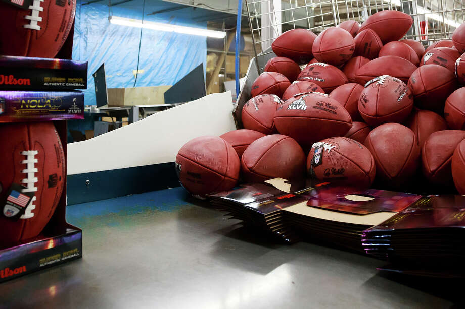 Official game balls for the NFL football Super Bowl XLVII at the packaging station in the Wilson Sporting Goods Co. in Ada, Ohio, Monday, Jan. 21, 2013. The San Francisco Forty Niners will play the Baltimore Ravens in the Super Bowl on Feb. 3 in New Orleans. (AP Photo/Rick Osentoski) Photo: Rick Osentoski, ASSOCIATED PRESS / AP2013