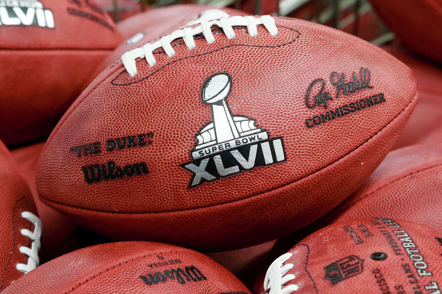 Footballs selected as actual official game balls for the NFL football Super Bowl XLVII await to be s